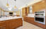 Ample Kitchen Storage in Custom Cabinets and Built-In Oven/Microwave.