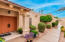 Lush landscaping with Terra Cotta entry