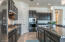 Gourmet kitchen with gas cooktop wall and microwave oven