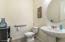 Powder room off of main living room and kitchen