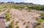 1.385 acre, level, buildable lot with wash behind and surrounding mountain views.