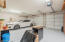 Garage with built-in cabinets and epoxy floor