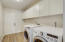 Very large laundry room with tons of storage, high quality washer and dryer