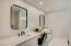 Elegant ALL NEW primary bathroom has dual sinks and beautiful quartz counters