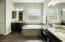 Granite counters, separate raised vanities, tile tub surround