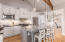 Open chef's kitchen with beautiful wood truss