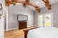 Large Primary bedroom with wood beam truss and backyard exit doors