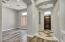 Rotunda Style Entry way with custom tile work with view of den