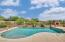 Luxury swimming pool with view fencing and outdoor fireplace