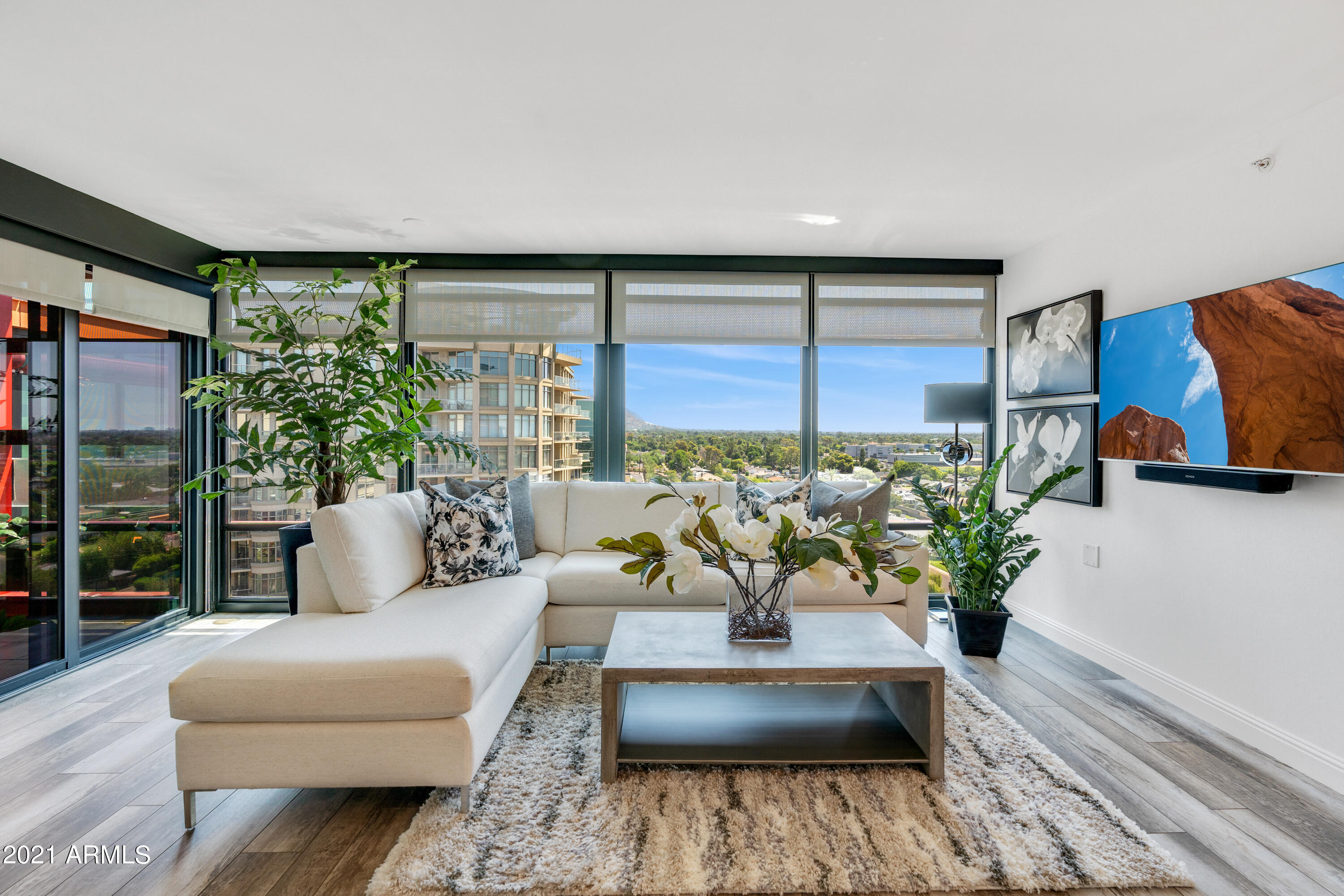 Completely remodeled unit with amazing lush green valley views from both living room and master. Redesigned kitchen now offers two full walls of cabinets and counter space featuring beautiful marble details. The large master opens up to the patio and offers a spacious walk in closet. Instant hot water and soft water. The upgraded bathroom offers a light and bright palate rarely found in these units! Enjoy 360 views from the green rooftop common area and pool! Optima is conveniently located walking distance to some of the valleys best shopping and dining as well as Lifetime fitness. Location offers quick access to freeways and very short commute to the airport!This rare floor plan offers a wide open living room with no obstructing column!