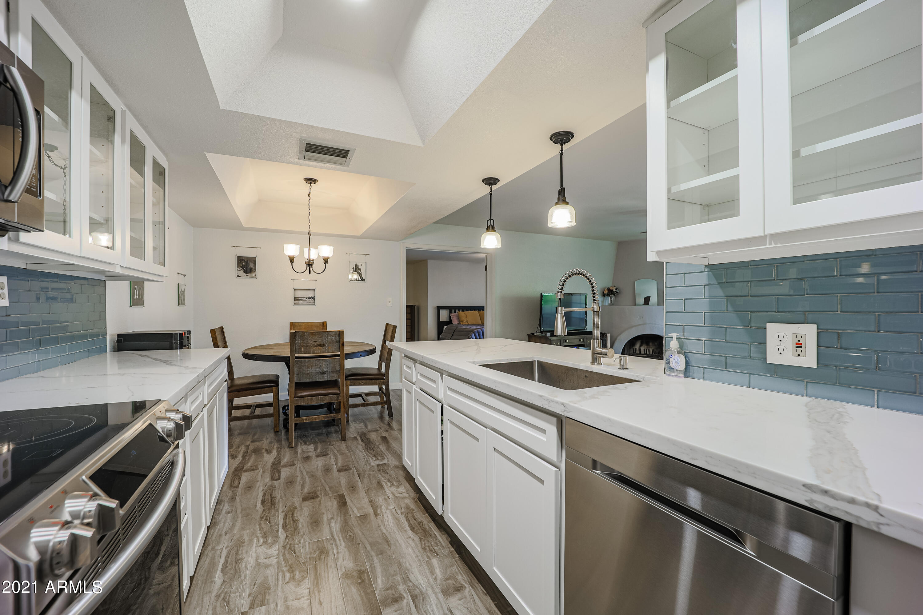 Hurry and get a showing in while you can because this beautifully updated 3 bed/2 bath condo will not last long! Located in the gated Pointe Tapatio Resort community, this second floor unit offers pool and mountain views from the covered patio. The spacious interior concept features wood-look tile, a corner adobe fireplace, and an open eat-in kitchen with a breakfast bar, subway tile backsplash, shaker-style cabinetry, quartz countertops, and sleek stainless steel appliances. The oversized master retreat features a nicely updated en-suite bathroom and private balcony. Enjoy interior laundry, three community pools, tennis courts, covered parking, and easy access to fantastic hiking trails at the nearby Phoenix mountain preserve.
