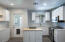 Custom title kitchen backslpash that goes all the way up the wall!