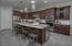 Kitchen w/ss appliances, granite countertops, picket style backsplash, built in wine fridge, and eat in kitchen. Large pantry with stand alone freezer (included)