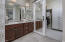 """primary bathroom with recently installed Barn door for """"his' closet. One of two master closets"""