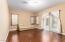 Bonus Living Room W/ Sliding Door to Courtyard, Next to En Suite and Single Car Garage.