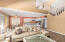 open floor plan family room, kitchen with breakfast nook.