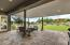 You've got it made in the shade under this extended covered patio!