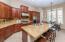 Kitchen with Slab Granite Counters and Backsplash