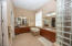 Owner's Bath with Walk-In Shower, Garden Tub and Dual Sinks and Vanities and Walk-In Closet