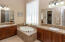 Owner's Bath with His/Her Vanities and Soaking Tub