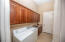 Laundry with Utility Sink, Matching Cabinetry, AND Garage Interior Access.