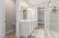 Master bathroom with large walk in shower, dual vanities, walk in closet