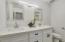 New dual vanities, tub with shower and shower door