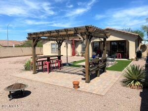Pavers/Firepit/Pergola/Artificial Grass as you walk out of the home.