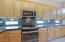 Built-in microwave. Notice the undercabinet lighting