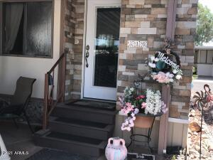 Pretty stone front entry with updated steps and attractive entry door.
