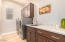 Large laundry room with cabinets and utility sink