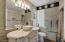 Fully remodeled bathroom with antique style vanity