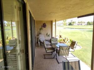 Large covered patio off of the Great Room. Lush green acres of grass; sunny Southern exposure & view of the Lake & Golf Course.