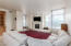 Spacious great room with fireplace and balcony access.