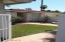 GATED front courtyard entry with fountain, roses, and small grassy area.