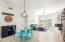 Great Room with open floorplan highlighting quartz, gas fireplace