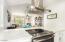 Kitchen boasts stainless steel appliances