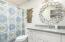 Guest Bathroom has elegant mirror, skylight, and bathtub