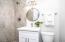 En-suite Master Bathroom with tiled showers, NEW vanity and flooring