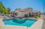 """This 1/4 acre lot boasts a pebble tech pool, """"secret"""" garden and a huge covered patio!"""