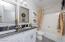 Hall bathroom with a tub