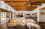 Great Room with Soaring Ceiling featuring Large Beams and Herringbone Vigas