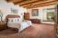 Master Bedroom featuring Large Viga Beems and Herringbone Viga Ceiling
