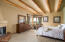 Second Master Bedroom featuring Beams and Fireplace