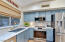 Pretty kitchen with gorgeous backsplash.