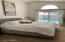 Master bedroom with slider doors to pool