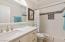 New vanity, tub surround, mirror, lighting.