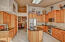 Updated kitchen with cherry raised panel cabinets, granite counters and stainless appliances