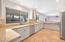 Kitchen with two tone cabinets and granite countertops