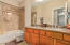 MASTER BATH SUITE WITH DOUBLE SINKS AND GRANITE TOPS